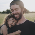 Man with daughter enjoying life